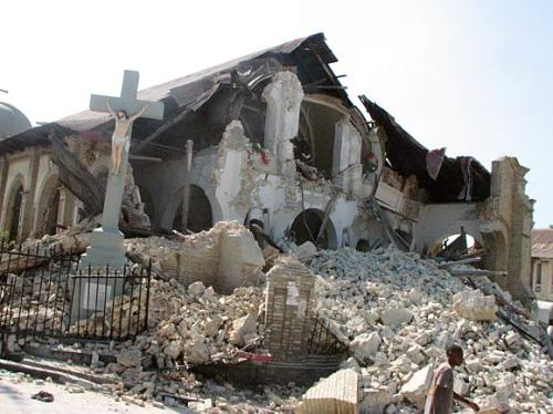 A cross stands amid the ruins of the Eglise Sacre Coeur (Sacred Heart Church), in downtown Port au Prince, Haiti